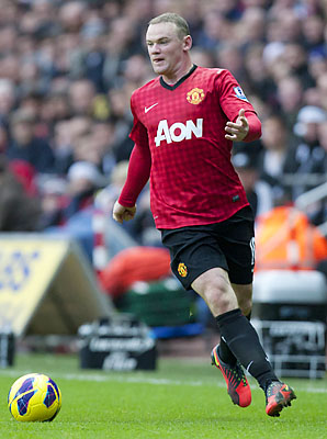 Wayne Rooney and Manchester United lead the Premier League and are into the final 16 of the Champions League.