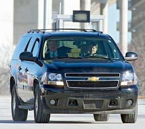 Andy Reid (left) and Chiefs owner Clark Hunt drive from Arrowhead Stadium to the team's practice facility.