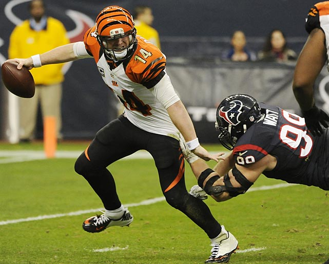 Bengals quarterback Andy Dalton is pressured by J.J. Watt, who had five tackles and one sack in Houston's 19-13 win.