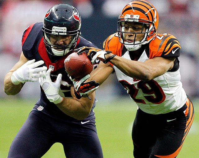 <italics>(Ten shots from each wild card game, starting with Houston-Cincinnati.)</italics> Leon Hall of the Bengals intercepted this pass intended for James Casey and returned it 21 yards for a touchdown. It was his team's only touchdown in the 19-13 loss.