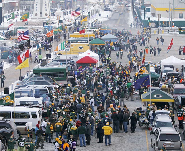 Fans tailgate at Lambeau Field before the Green Bay-Minnesota Vikings wild card game.