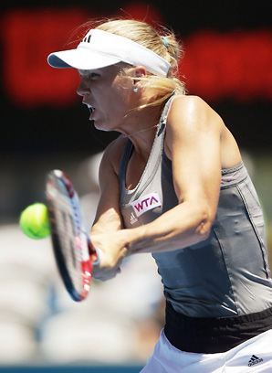 Caroline Wozniacki dominated Poland's Urszula Radwanska to open the Sydney International.