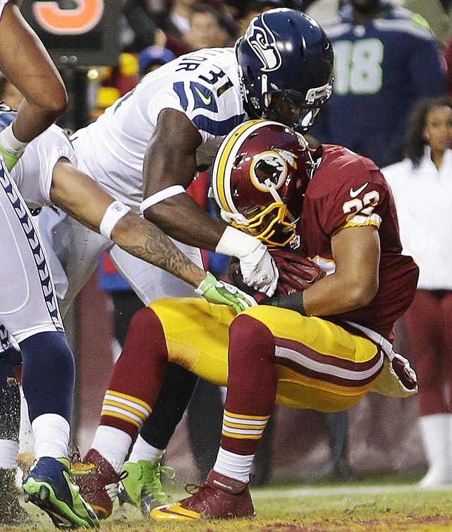 Evan Royster caught a four-yard scoring pass from Robert Griffin III to give Washington an early 7-0 lead. The Redskins led 14-0 before the Seahawks stormed back.
