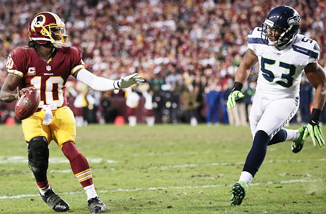 Robert Griffin III injured himself while being pursued by Malcolm Smith in the first quarter.