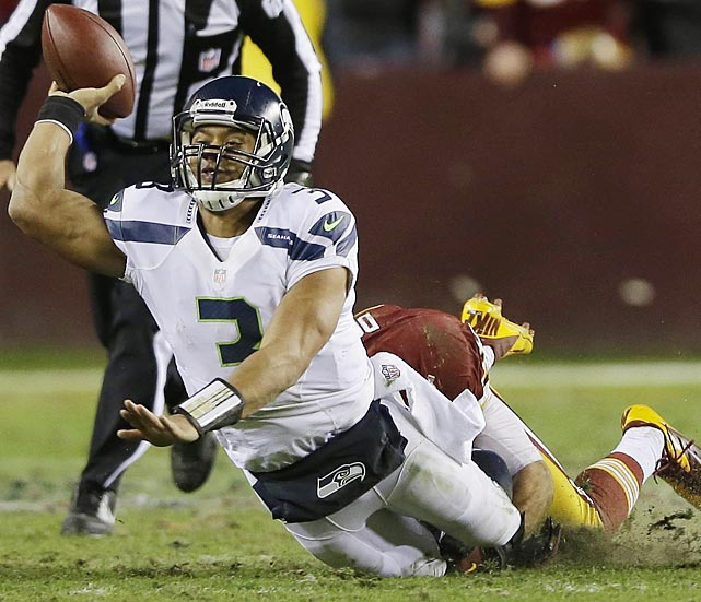 Reed Doughty brought down Russell Wilson before he could attempt a pass on this play.