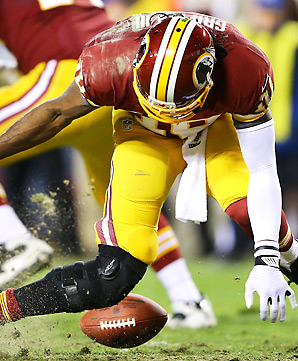 Robert Griffin III was hobbled for most of the Redskins' game against the Seahawks, before buckling his knee on this play late in the fourth quarter.