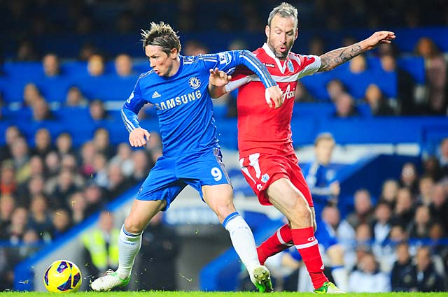 Fernando Torres battles with Shaun Derry of QPR during a Premier League match last week.