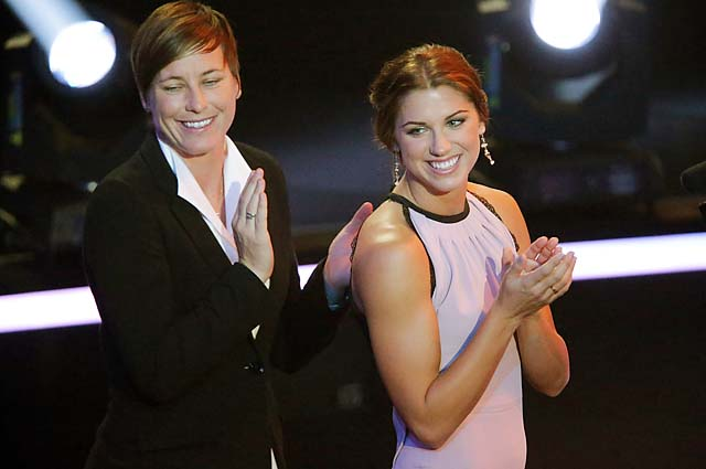 Abby Wambach and Alex Morgan applaud Pia Sundhage winning the coach of the year award.