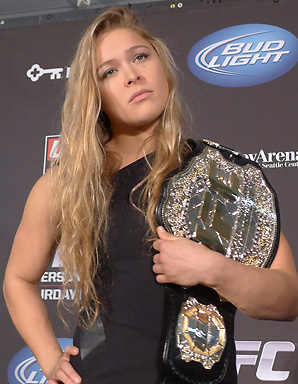Former judo bronze medalist Ronda Rousey has dominated her six fights in mixed martial arts. Her new UFC contract could earn her unforeseen money.