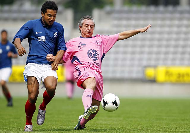 Alain Giresse (right) plays during a friendly against media in May.