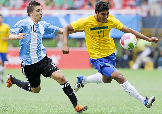 Rafael struggles for the ball with Adrian Martinez of Argentina during a match as part of 2011 Pan American Games.