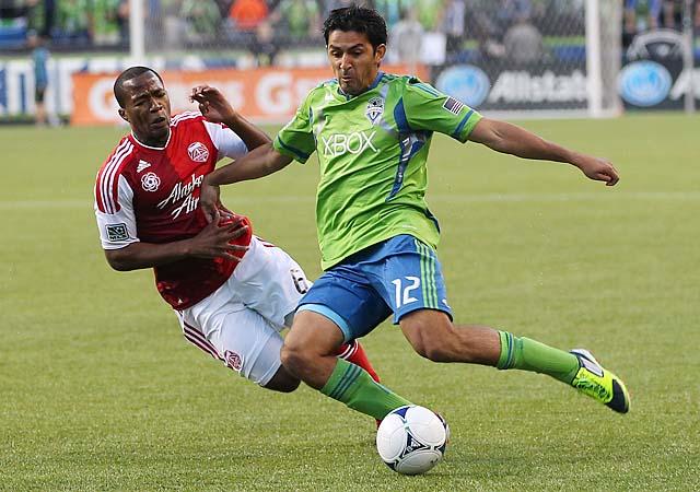 Leonardo Gonzalez (right) and Darlington Nagbe battle during a Seattle-Portland rivalry match last season.