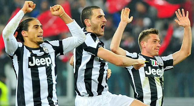 Martin Caceres (left), Leonardo Bonucci (center) and Emanuele Giaccherini celebrate Juventus' win.