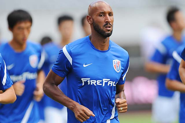 Nicolas Anelka takes part in a team training session at Shanghai Stadium in 2012.