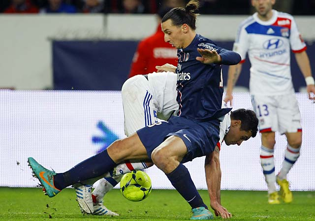 Zlatan Ibrahimovic (front) challenges Dejan Lovren in a Ligue 1 match.