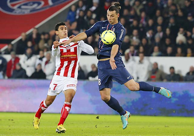 Zlatan Ibrahimovic controls the ball against Benjamin Andre of Ajaccio.