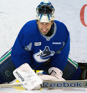 Canucks goalie Roberto Luongo returned to the ice for an informal workout with his teammates Friday while facing an uncertain NHL future.