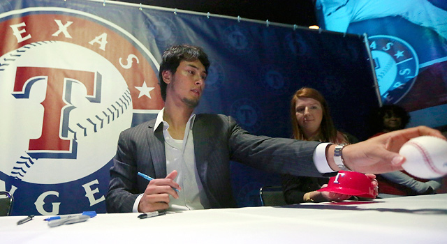 Yu Darvish signed autographs at the Rangers' annual Fan Fest at the Arlington Convention Center.