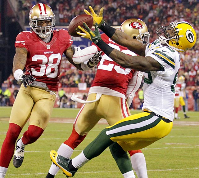 Packers wide receiver James Jones catches a pass as Chris Culliver (29) and Dashon Goldson attempt to intercept it.