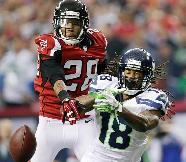 Thomas DeCoud knocks down a pass intended for Sidney Rice, who was held to four catches for 60 yards and no touchdowns.