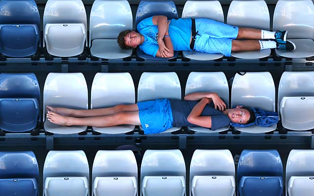 Fans lie across seats in the stands during Fernando Verdasco's 6-3, 3-6, 4-6, 6-3, 6-3 win over David Goffin.