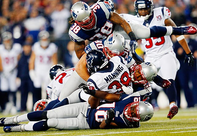 Danieal Manning gets tackled by Matthew Slater (18), Niko Koutouvides (90), Marquice Cole (23) and Brandon Bolden (38). Manning averaged 54 yards on four kickoff returns.
