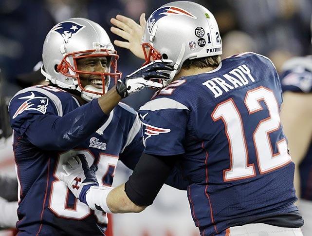 Brandon Lloyd and Tom Brady high-five after their five-yard touchdown pass and catch put the Patriots up 31-13 in the third quarter.