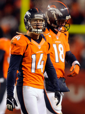 Brandon Stokely (14) and Peyton Manning came up short after earning the AFC's No. 1 seed.