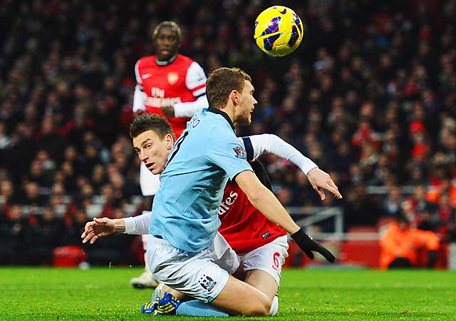 Laurent Koscielny fouled Edin Dzeko in the ninth minute, earning a red card and a City penalty.