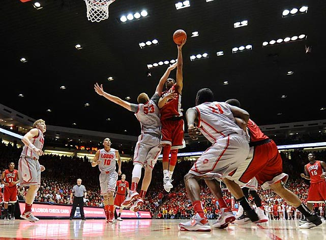 New Mexico center Alex Kirk contests a shot in the lane from UNLV forward Khem Birch in a Mountain West Conference game on Jan. 9. Kirk dominated the game with 23 points and nine rebounds to lead the Lobos to a 65-60 win.