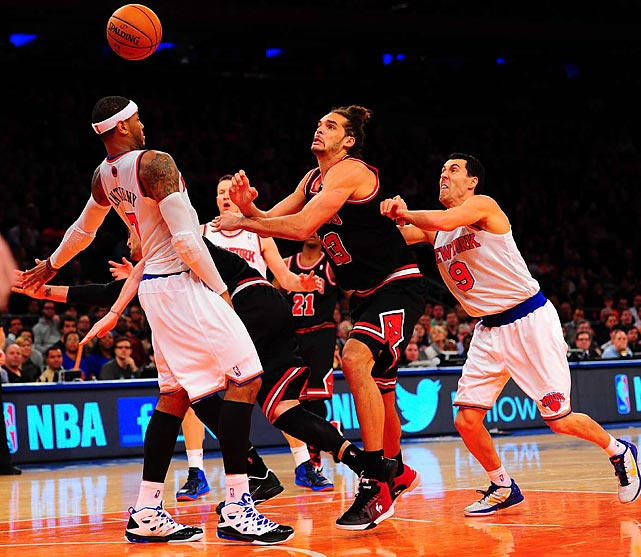 Chicago Bulls center Joakim Noah watches the ball float over the head of New York Knicks small forward Carmelo Anthony in the Bulls and Knicks' Jan. 11 game at Madison Square Garden. Despite 39 points from Anthony, Noah's Bulls came away with the victory, 108-101.
