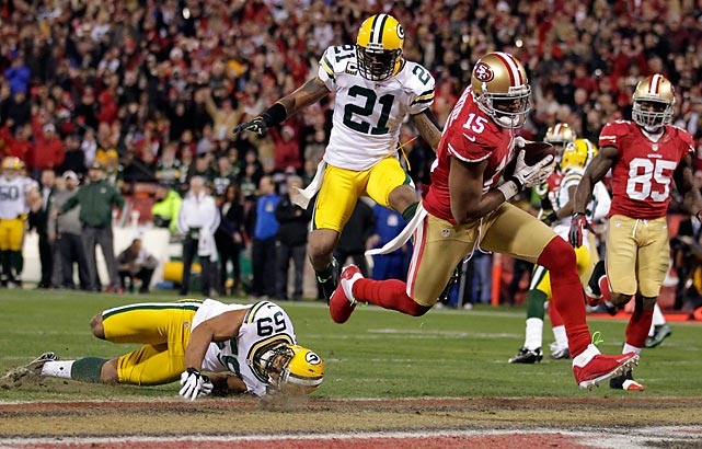 San Francisco 49ers wide receiver Michael Crabtree splits Brad Jones and Charles Woodson of the Green Bay Packers to reach the end zone for the first of his two touchdowns in the 49ers' 45-31 win over the Packers. San Francisco's win earned it a shot at the NFC Championship against the Atlanta Falcons.
