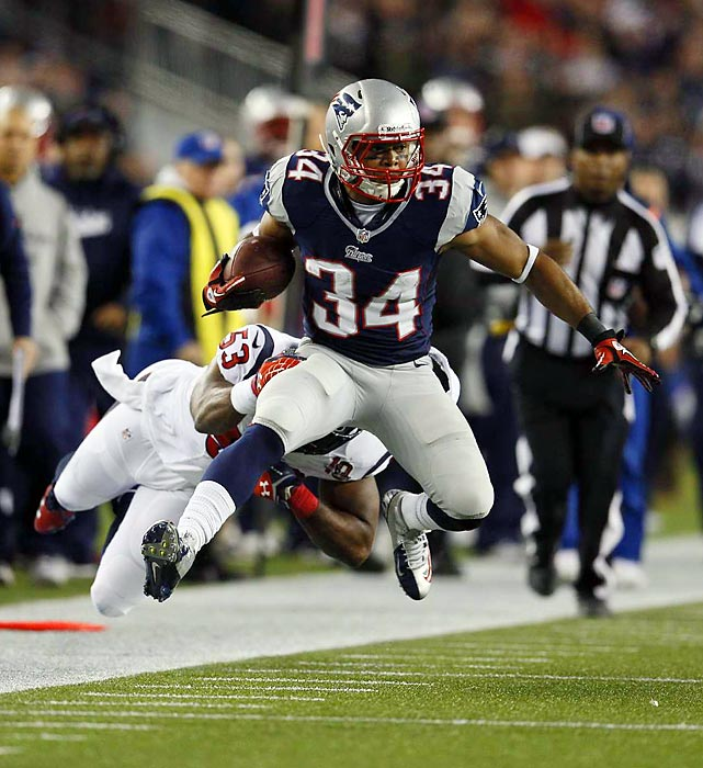 Houston Texans linebacker Bradie James dives at the heels of New England Patriots running back Shane Vereen in the Patriots' 41-28 victory over the Texans. Vereen scored three touchdowns, running for one and catching two.