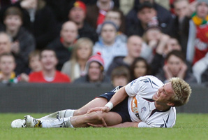 Stuart Holden injured his right knee in a Premier League game on March 19, 2011.