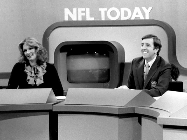 "Phyllis George sits alongside Brent Musburger on the set of ""NFL Today"" on CBS."