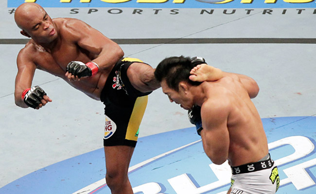 Anderson Silva (left) will await Michael Bisping if Bisping can get past Vitor Belfort on Jan. 19.
