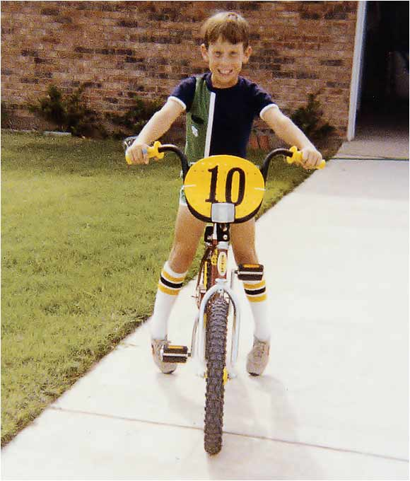Lance Armstrong was already taking to his bicycle at age 8.
