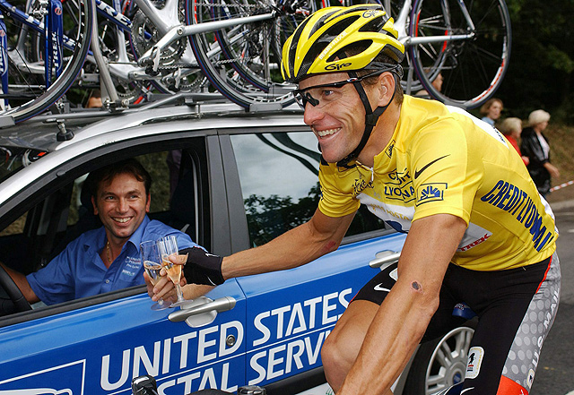 Armstrong celebrates his fifth straight Tour de France victory with team chief Johan Bruyneel on his way to the Champs-Elysees in Paris.