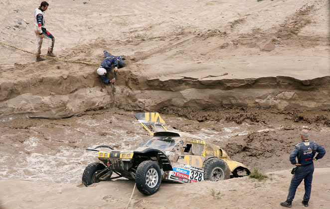 Floods shortened Wednesday's 137-mile stage on the sand dunes to just 33.