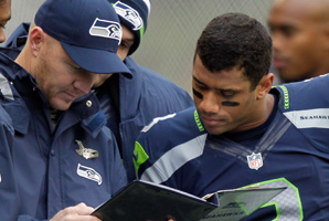 Darrell Bevell, shown here with Seahawks rookie Russell Wilson, has a career of working with successful quarterbacks.