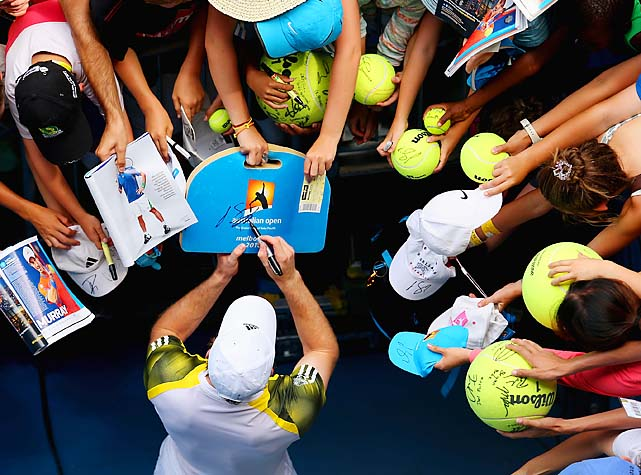Murray signs autographs after his match at Hisense Arena.