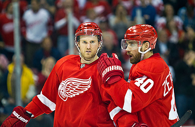 "Replacing Nicklas Lidstrom will be no easy task, but this pair of Wings will try to make up for his absence and sustain Detroit's run of consecutive playoff appearances (now at 21). The hard-hitting Kronwall, an assistant captain, is now the mainstay of the blueline corps, and a stylistic departure from Lidstrom's savvy positional play. The much respected Zetterberg, 32, has been given Lidstrom's C and, like the recently retired future Hall of Famer, will lead by quiet, productive example. ""He's a leader of men,"" coach Mike Babcock said. ""He's a fierce competitor."""