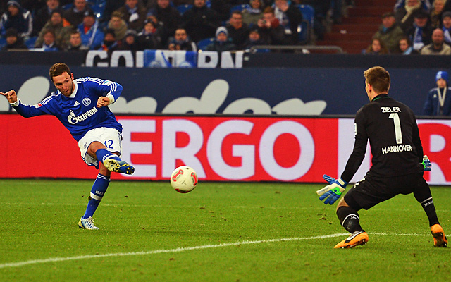 Marco Hoeger (left) scored the third goal for Schalke, which had been second in the standings.