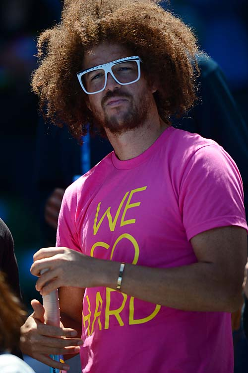 Redfoo from LMFAO looks on from Azarenka's match.