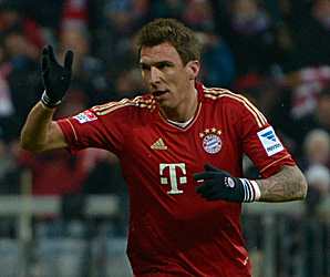 Mario Mandzukic brought his season total to 11 goals by scoring in each half in Munich.