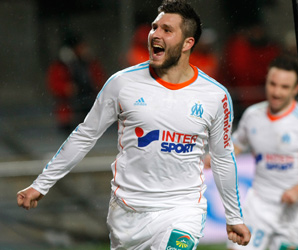 Andre-Pierre Gignac celebrates his injury-time winner over Montpellier.
