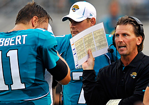 Greg Olson (right) had been the Jaguars' quarterbacks coach.