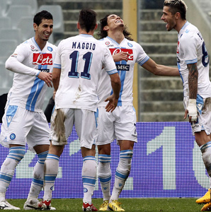Edinson Cavani (second from right) and his Napoli teammates celebrate his game-tying goal against Fiorentia.