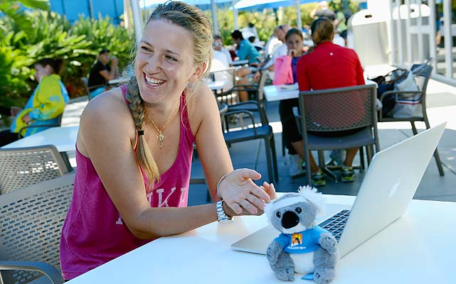 Azarenka watches herself play the piano on a laptop.