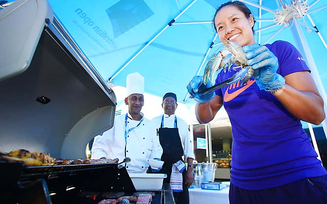 Li celebrates her win by barbequing prawns in the players' cafe.